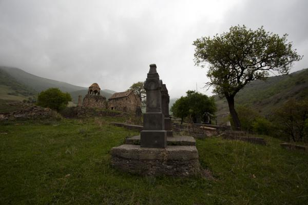 Picture of Ardvi (Armenia): Cemetery and tree with the Monastery of St. John visible behind