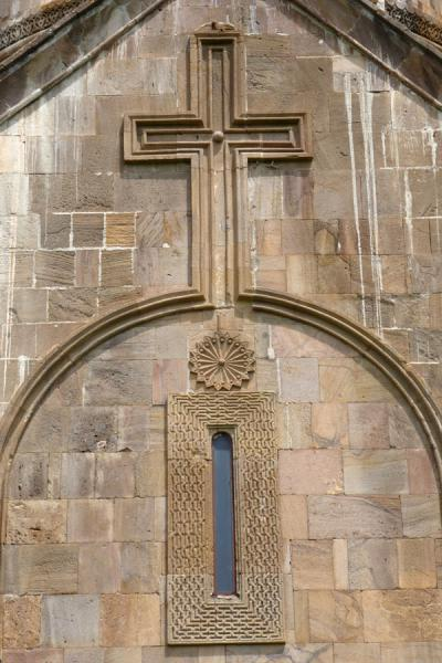 Picture of Gandzasar Monastery (Armenia): Cross and Wheel of Eternity carved out of the wall of Cathedral of St. John the Baptist