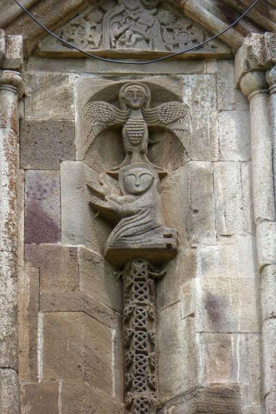 Picture of Gandzasar Monastery (Armenia): Kneeling figure with angel in bas-relief on the tambour of Cathedral of St. John the Baptist