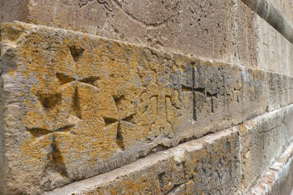 Picture of Gandzasar Monastery (Armenia): Close-up of the wall of Cathedral of St. John the Baptist with crosses carved out
