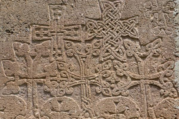 Picture of Gandzasar Monastery (Armenia): Fragment of the wall of Gandzasar Monastery with crosses carved out of the wall