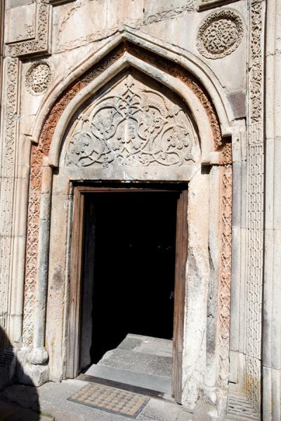 Picture of Geghard monastery (Armenia): Elaborately decorated entrance door of the Geghard Monastery