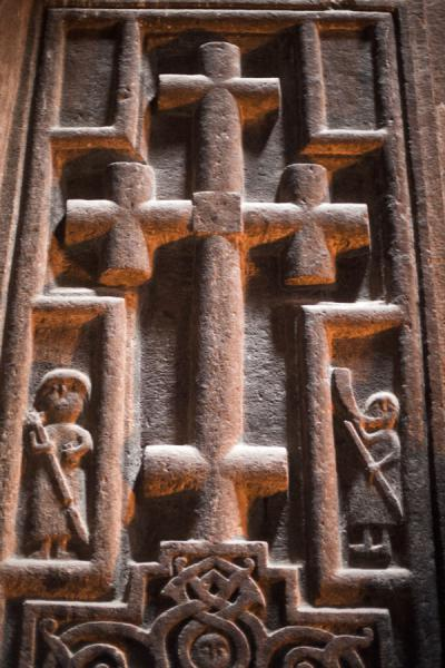 Cross with figures inside Geghard Monastery | Geghard monastery | Armenia