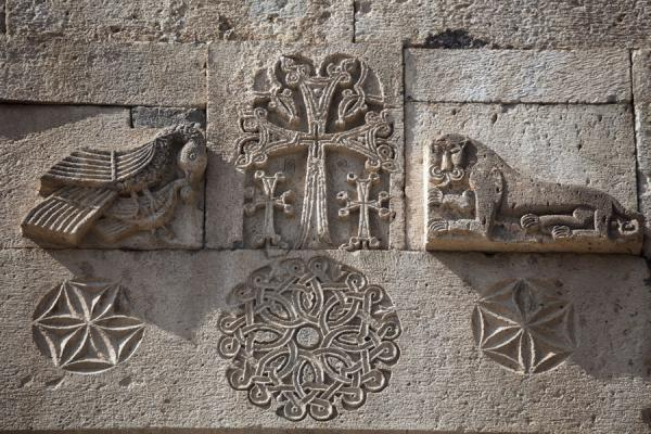 Picture of Geghard monastery (Armenia): Doves and lion on both sides of a cross carved out on the wall of the gavit of Geghard Monastery