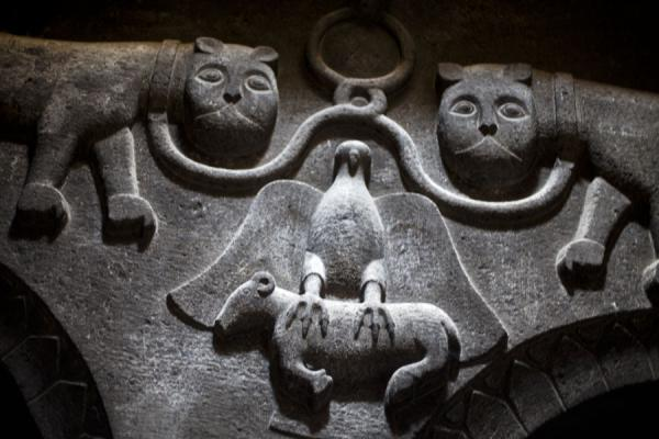 Fragment of a relief showing an eagle with lamb in its claws with two lions | Geghard monastery | Armenia