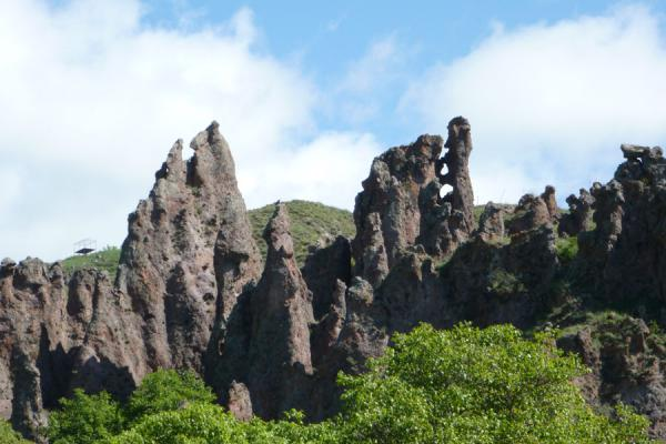 Picture of Goris cave dwellings (Armenia): Pinnacles on green hills are the setting for the cave dwellings of Goris
