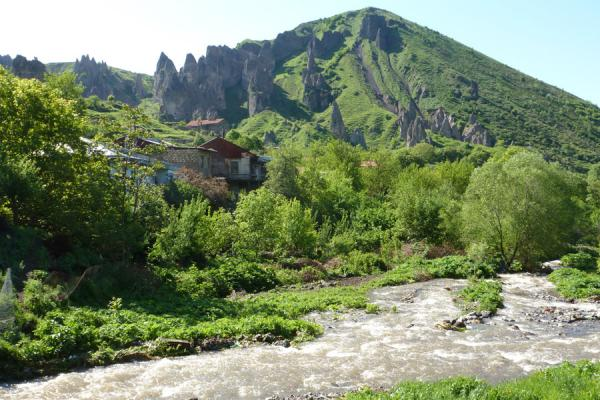 Picture of Goris cave dwellings (Armenia): Green landscape with pinnacles and river outside Goris