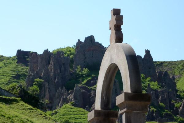 Picture of Goris cave dwellings (Armenia): Arch at the cemetery of Goris with pinnacles in the background