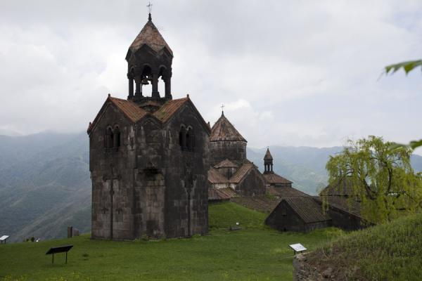 Bell tower with the main complex of Haghpat behind | Haghpat monastery | Armenia