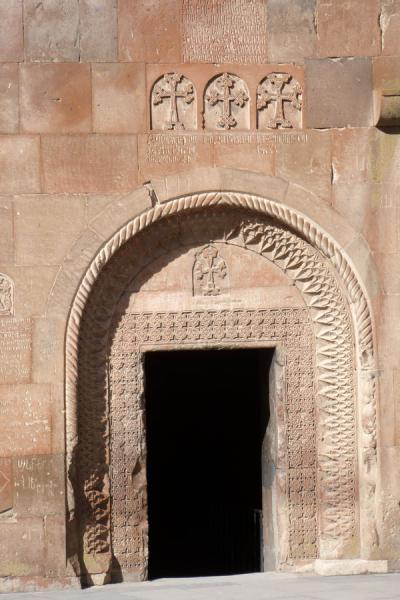 Picture of Entrance of St Gevorg chapel with a decorated arch and three crosses aboveKhor Virap - Armenia