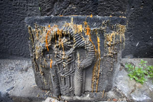 Picture of Kobayr Monastery (Armenia): Detail of a carved stone with melted candles in the church of Kobayr Monastery