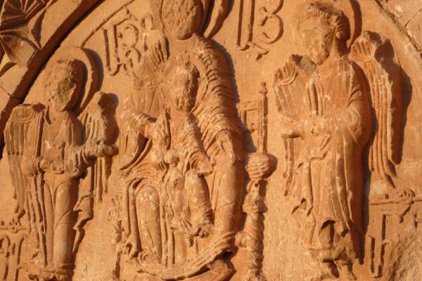 Virgin Mary and child with angels carved out by Mamik above the entrance of the Orbelian mausoleum | Monastère de Noravank | Armenia