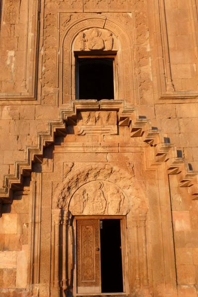 Doors, stairs, and carved tympanums at the Mother of God church | Monastère de Noravank | Armenia