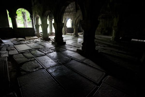 Interior view of the gavit of the Mother of God Church with tombstones on the floor | Sanahin Monastery | Armenia