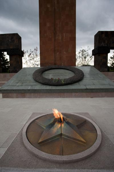 The eternal flame is the centre of the memorial complex, the obelisk can be seen behind | Stepanakert Memorial Complex | Armenia