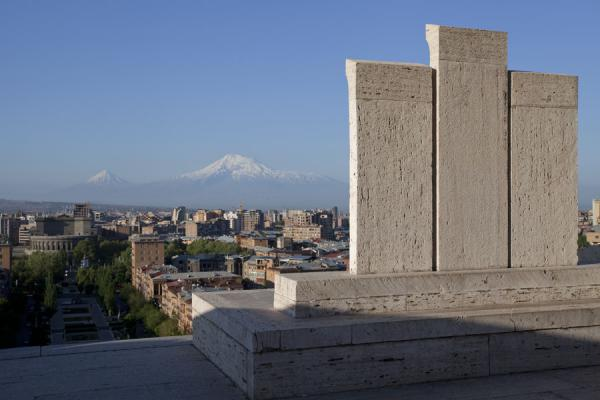 Three modern khachkars at the top of the Cascade with a view over the city and Mount Ararat in the distance | Yerevan Cascade | Armenia