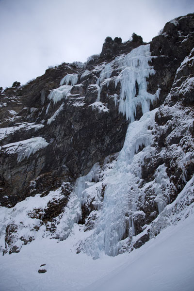 Foto van Rockface covered in snow and ice - the terrain for ice-climbingTirol - Oostenrijk