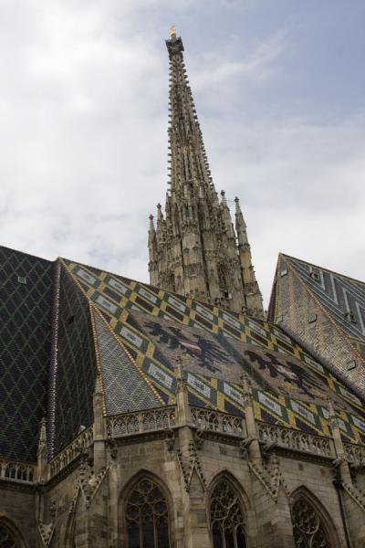 Picture of View of the Stephansdom from below with the Austrian eagle depicted on the roof