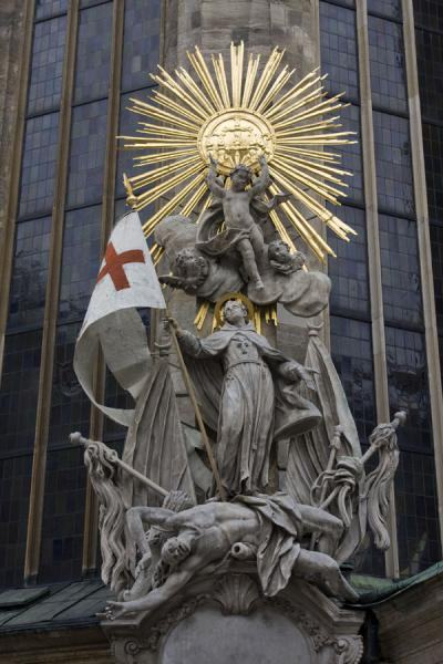 Detail of a religious scene on the outside of the Stephansdom | Stefansdom | Oostenrijk
