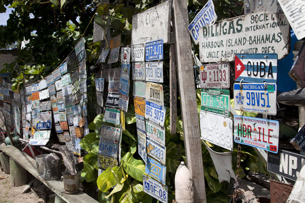 International licence plates and driftwood on display on Dunmore Street | Dunmore Town | Bahamas