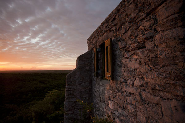 The last rays of sunshine falling on a window of the hermitage of the Mount Alvernia | Mount Alvernia Hermitage | Bahamas