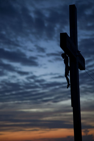 Cross in front of the hermitage on Mount Alvernia at dusk | Mount Alvernia Hermitage | Bahamas