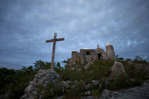 Picture of Looking up the hermitage at Mount Alvernia with cross and the tiny churchMount Alvernia - Bahamas