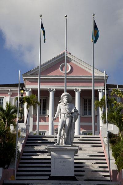 Statue of Christopher Columbus on the stairs leading up to pink Government House | Nassau Old Town | Bahamas