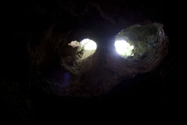 Foto van The Binocular: two circular holes in the ceiling of Preachers CavePreacher's Cave - Bahamas