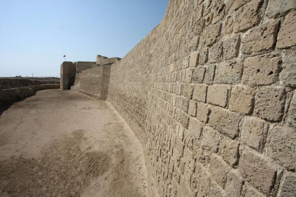 Defensive wall of Bahrain fort seen from the entrance | Bahrain Fort | Bahrain