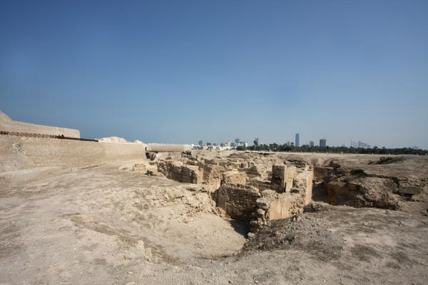 Ruins of ancient city with the skyline of Manama in the background | Bahrain Fort | Bahrain