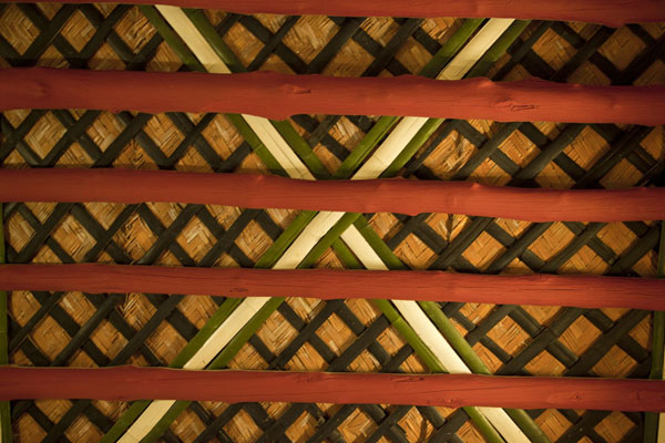 Looking up at the ceiling of one of the rooms with wooden beams | Bait Sheikh Isa bin Ali | Bahrain
