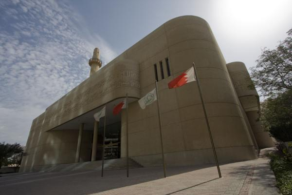 Flags and the Beit al Quran seen from a corner | Beit al Quran | Bahrain