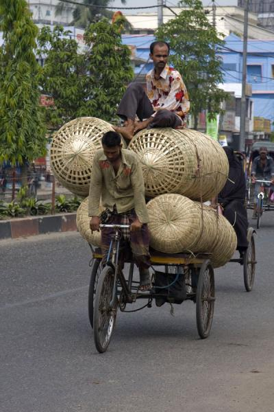 Picture of Bangla Pedal Power (Bangladesh): Strong Bangla biker pedaling his bike with baskets and friend forward