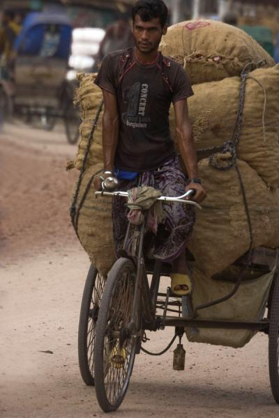 Picture of Bangla Pedal Power (Bangladesh): Man struggling to get his very heavy bike forward