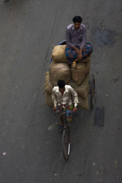 Picture of Bangla Pedal Power (Bangladesh): Man adding more weight to a heavily loaded bike