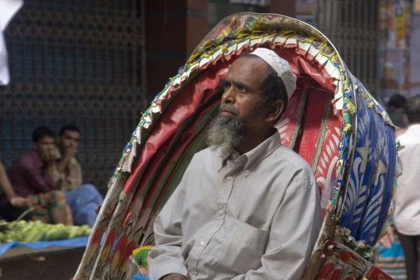 Man sitting in the back of a rickshaw | Bangladeshi rickshaws | Bangladesh