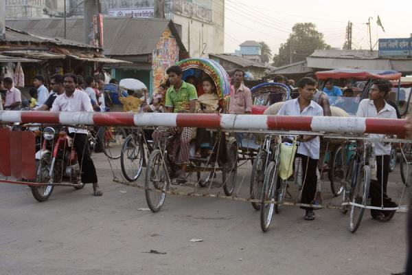 Rickshaws waiting for the train to pass | Bangladeshi rickshaws | Bangladesh
