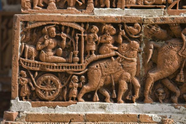 People, animals, and a cart depicted on one of the many scenes of Kantanagar temple | Kantanagar temple | Bangladesh