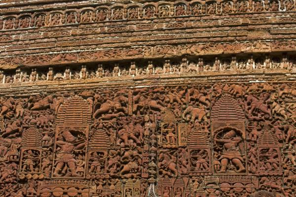 Picture of Kantanagar temple (Bangladesh): Intricate carved figures in a wall of Kantanagar temple