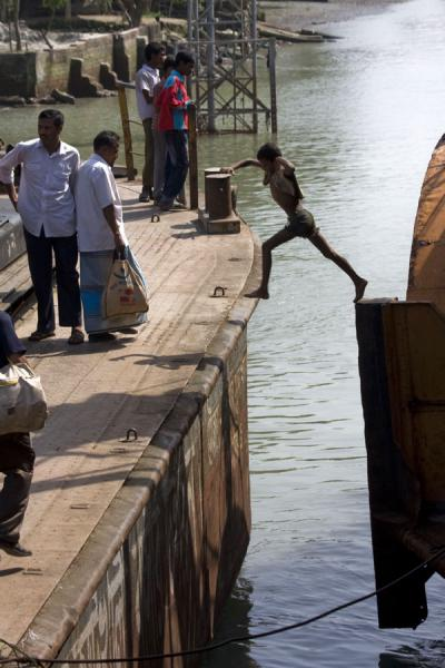 Picture of Rocket boat ride (Bangladesh): No time to waste: boy jumping off the Rocket at one of the stops