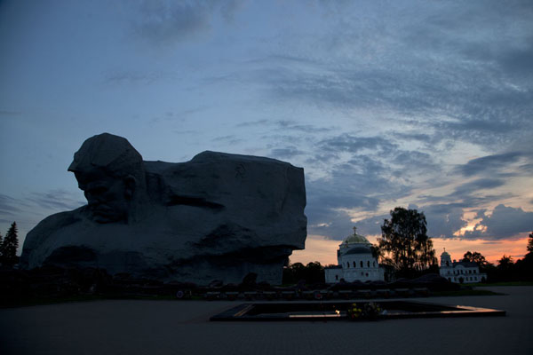 Picture of Sunset over the fortress of Brest with the contours of the Courage sculpture in the foregroundBrest - Belarus