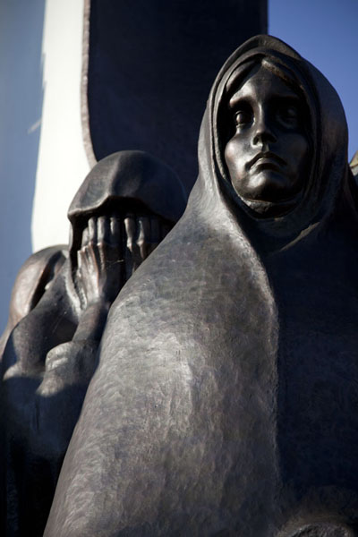 Row of weeping women surrounding the chapel | Island of Tears | Belarus