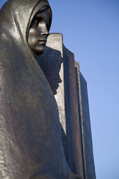 Picture of Close-up of one of the weeping ladies surrounding the monument on the Island of TearsMinsk - Belarus