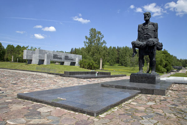 Picture of The Unconquered Man statue with the memorial on the site of the shed in the background - Belarus - Europe