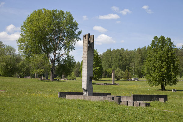 Each house is marked by the foundations, and a tower with a bell that rings every 30 seconds | Khatyn | Belarus