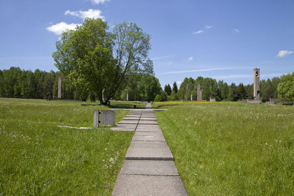 Concrete path through the village of Khatyn with markers where houses once stood | Khatyn | Belarus