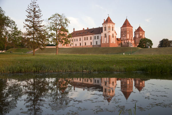 Picture of The evening sun shining on Mir castle with reflection in the water