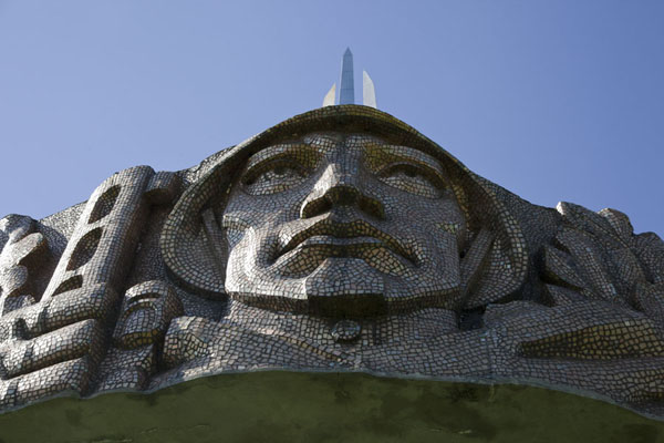 Soldier with a gun clinched to his hands and with solemn face | Mount of Glory | Belarus