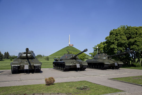 Picture of Soviet tanks next to the parking, with the Mount of Glory in the backgroundMinsk - Belarus